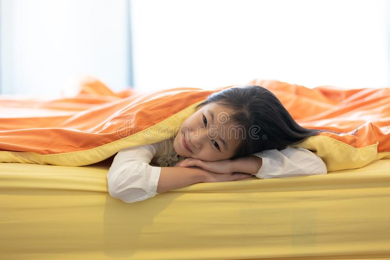 Portrait of little girl under blanket in the bedroom at home,child and home concept. Portrait of little girl under blanket in the bedroom at home, happy asian stock images