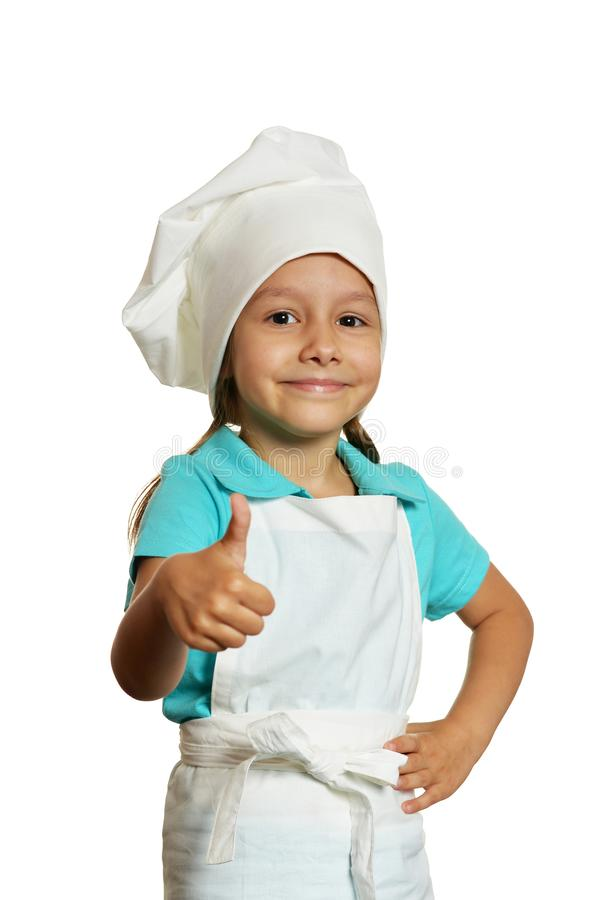 Portrait of little girl wearing chef uniform isolated on white background royalty free stock photography