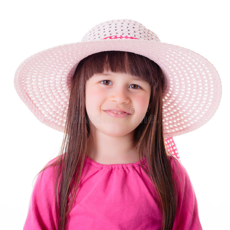 Portrait of little girl wearing pink summer hat stock photography