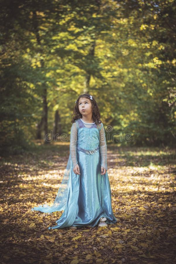 Little fashionable girl. Portrait of little girls in the woods,selective focus royalty free stock photography