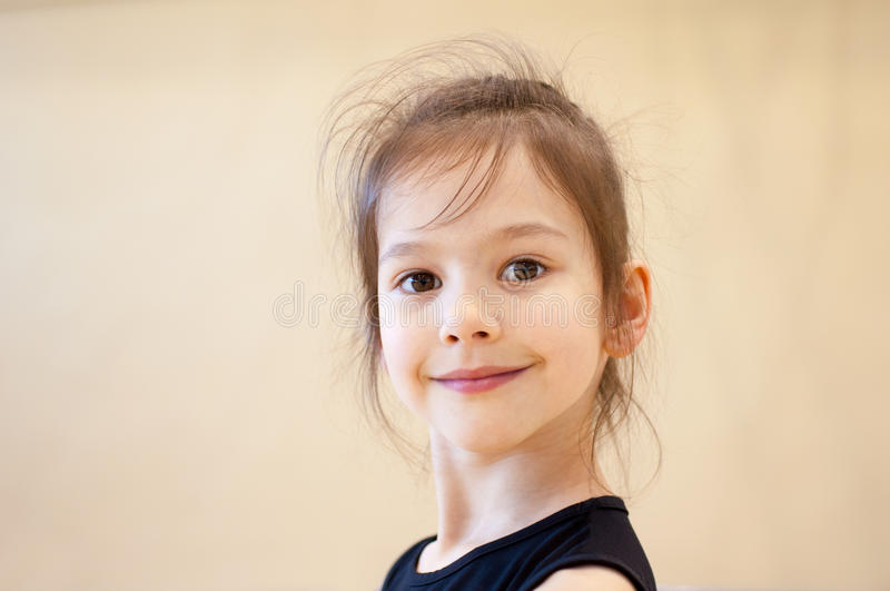 Portrait of little gymnast. Beautiful of little gymnast in gym royalty free stock photography