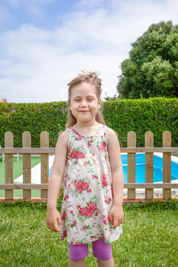 Portrait of little happy girl looking at next to a pool royalty free stock photos