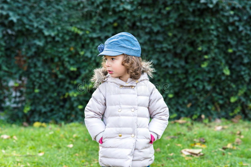 Portrait of little kid outdoor. Portrait of the little girl outdoor,selective focus stock photo