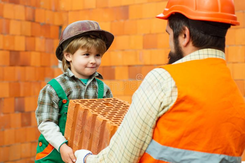 Portrait of a little man dressed as a construction worker. Happy Labor day banner, american background. Little boy helps royalty free stock images