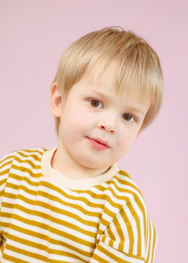 Portrait of little model boy. In studio royalty free stock images