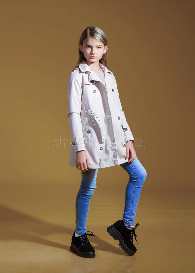 Portrait of little model girl. In studio stock image