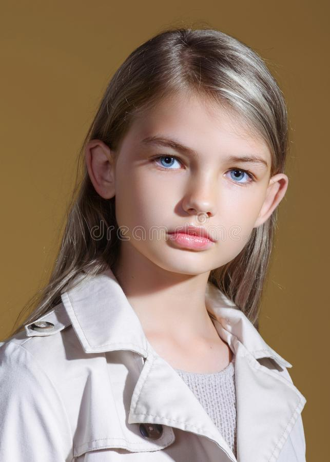 Portrait of little model girl. In studio stock photo