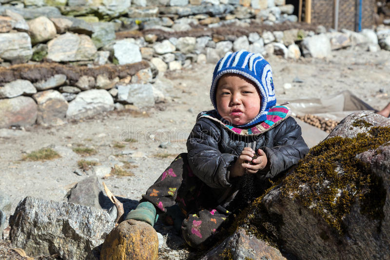 Portrait of little Nepalese Child in remote Himalaya Village royalty free stock image