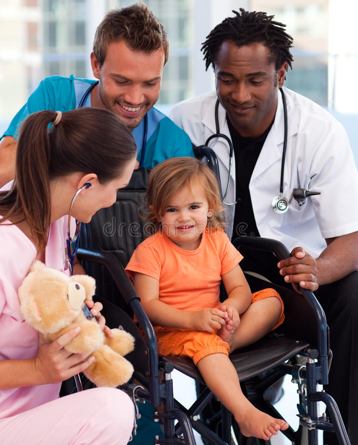 Portrait of a little patient with medical team royalty free stock photos