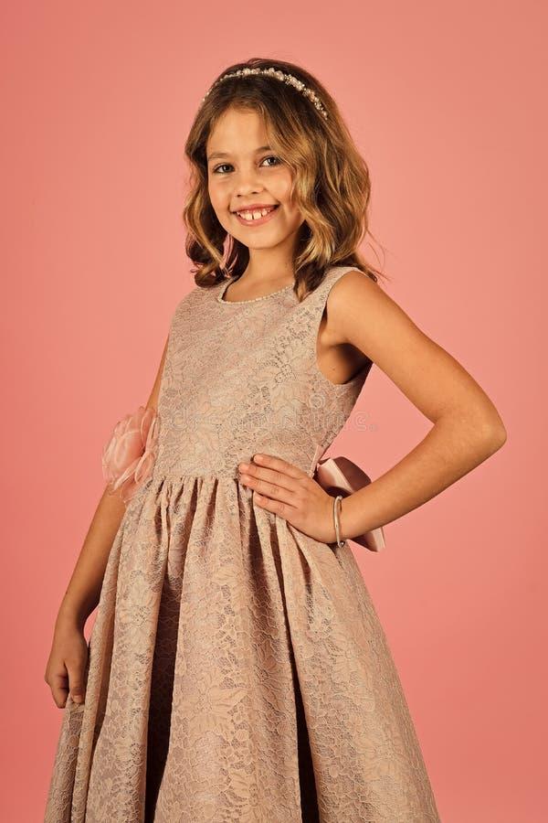 Beauty Fashion model girl. Fashion look. Portrait of little pin-up girl in pink dress. Portrait of little pin-up girl in pink dress. Beauty Fashion model girl stock photo