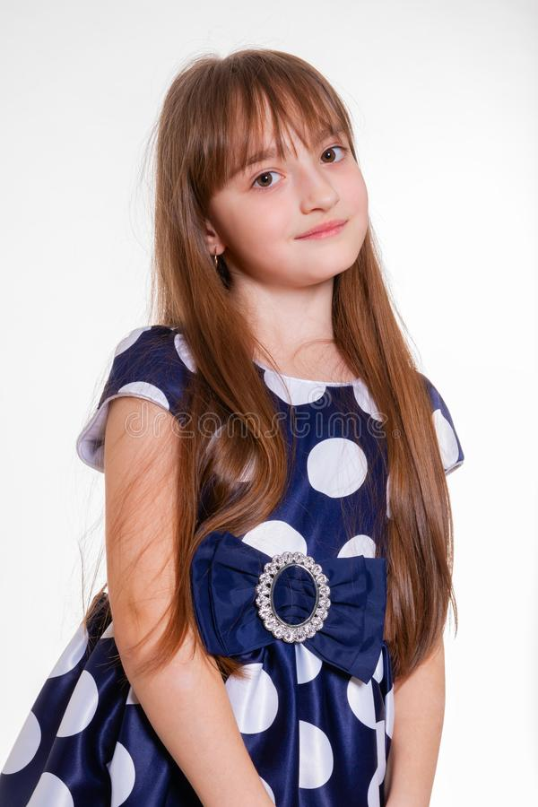 Portrait of a little positive schoolgirl in a polka dot dress stock photos