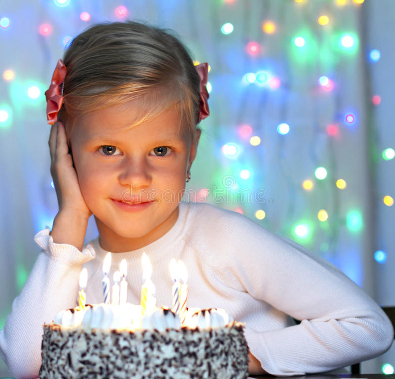 Portrait of little pretty girl with birthday cake royalty free stock image