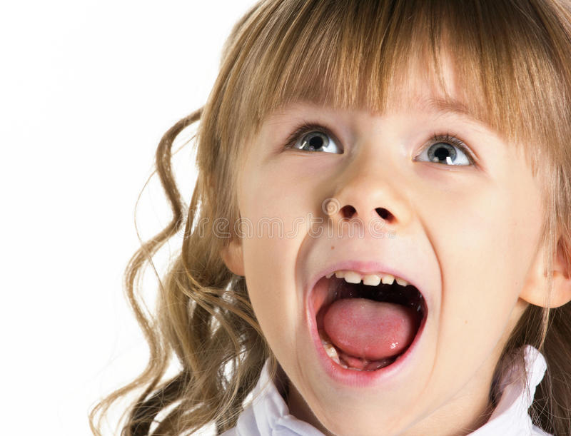 Portrait of a little screaming girl royalty free stock image