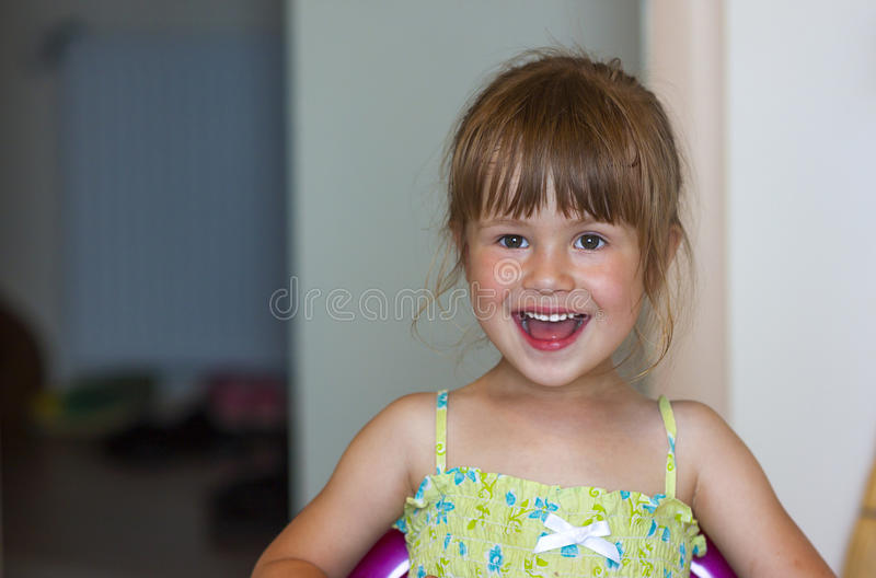 Portrait of a little smiling girl on blurred background stock photos