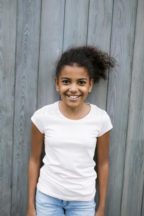 Portrait of a little smiling girl outdoors royalty free stock photo