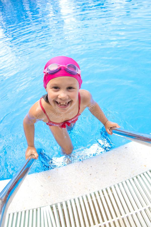 Girl swim in  pool royalty free stock photo