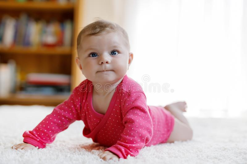Portrait of little tiny baby girl of 5 months indoors at home royalty free stock photography