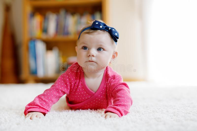 Portrait of little tiny baby girl of 5 months indoors at home stock image