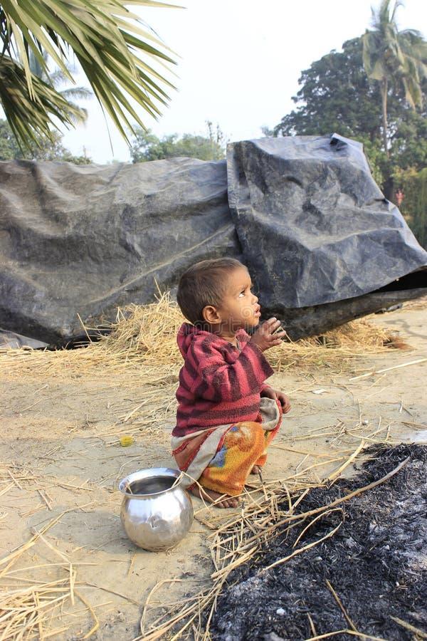 Portrait of a little vagabond kid. Homeless kid. royalty free stock image