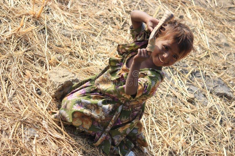 Portrait of a little vagabond kid. Homeless kid. stock image