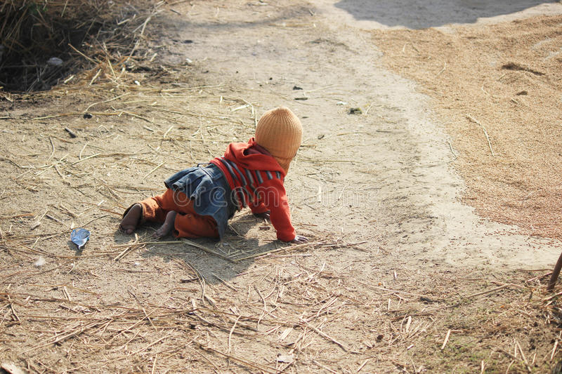 Portrait of a little vagabond kid. Homeless kid. royalty free stock images