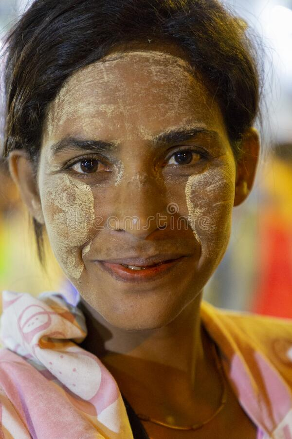 Woman with Thanaka on the face, Yangon, Myanmar royalty free stock image