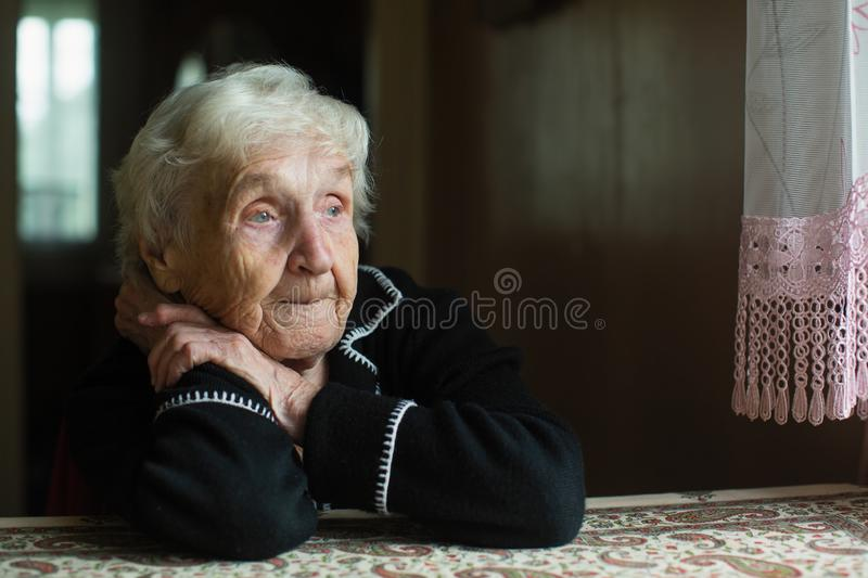 Portrait of a lonely old lady. royalty free stock images