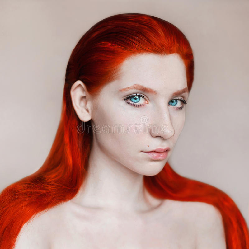 Portrait of long-haired naked red-haired stock photo