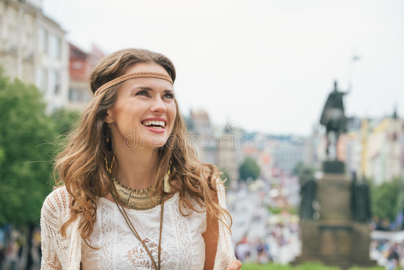 Portrait of longhaired hippy-looking woman tourist in Prague. Portrait of happy longhaired hippy-looking woman tourist enjoying sightseeing in Prague. In the stock photos