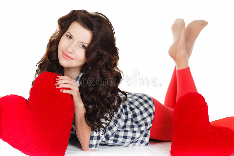 Portrait of Love and valentines day woman holding heart smiling cute and adorable isolated on white background. Beautiful woman in. Valentine's Day. Beautiful stock photo