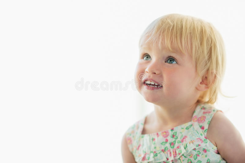 Portrait of lovely baby looking on copy space stock photos