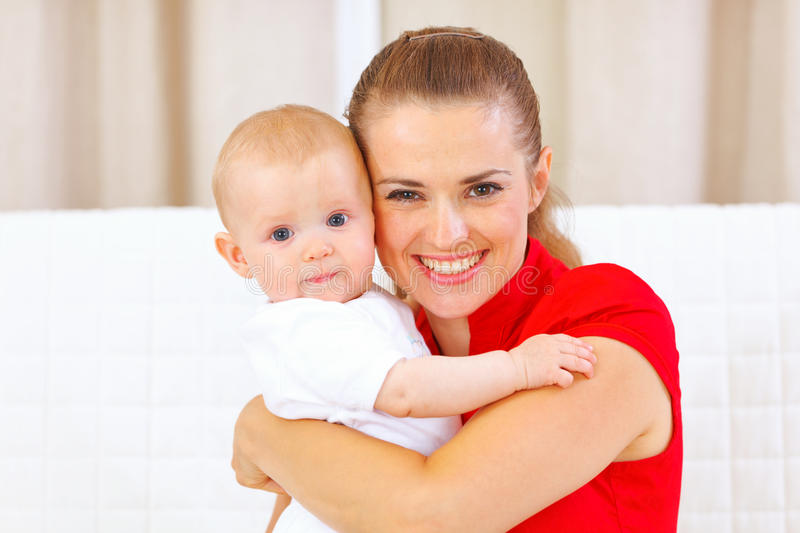 Portrait of lovely baby and young mother royalty free stock photography