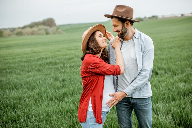 Lovely couple on the greenfield stock photos