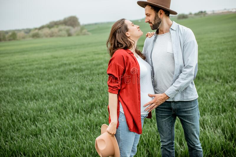 Lovely couple on the greenfield royalty free stock photo