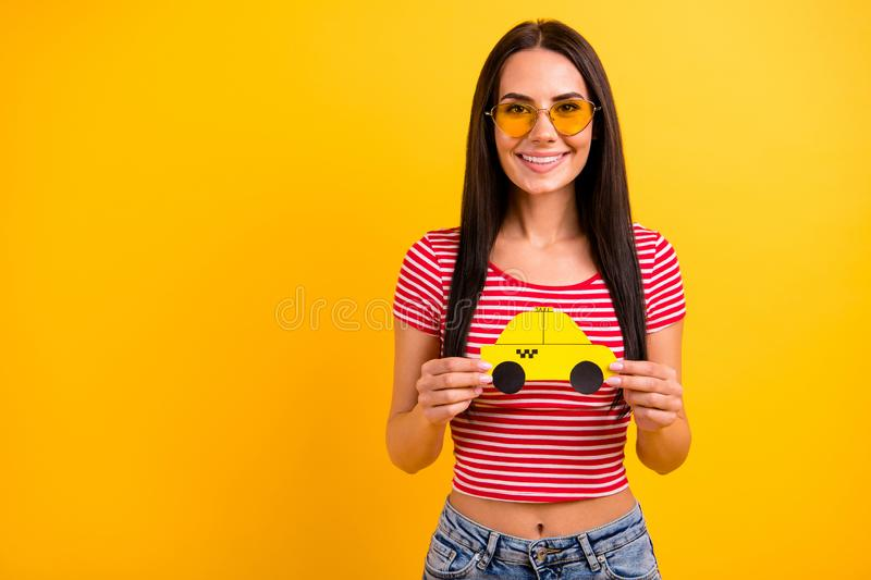 Portrait of lovely cute youth hold hand yellow paper card taxi car want ride feel positive cheerful satisfied enjoy. Portrait of lovely cute youth hold hand stock photo