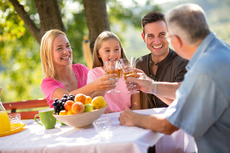 Portrait of lovely family having picnic. In nature stock images
