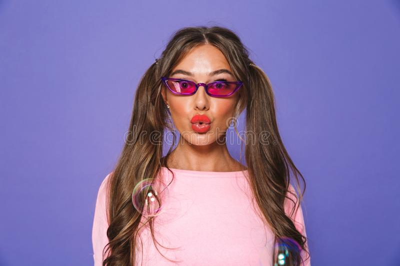 Portrait of a lovely girl in sweatshirt in sunglasses royalty free stock photo
