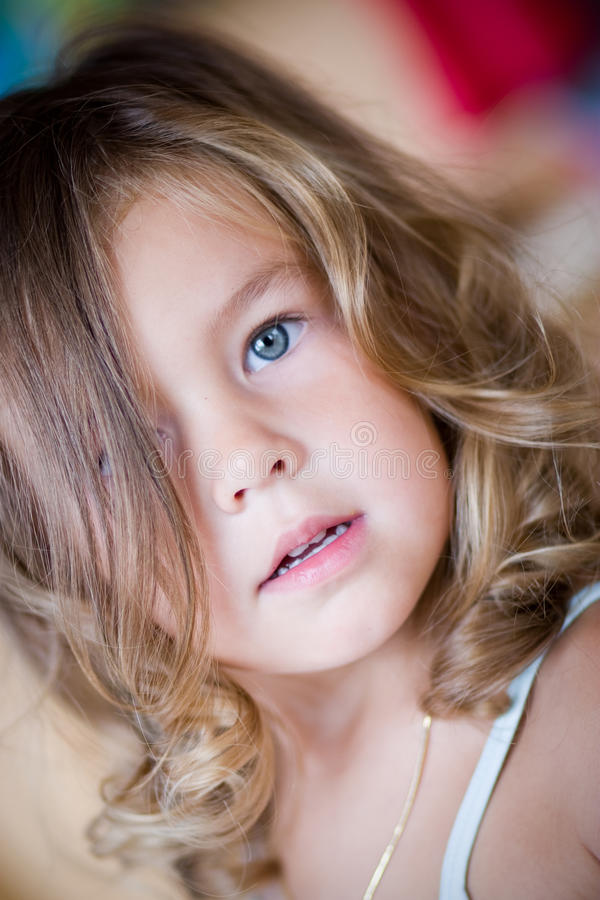 Portrait of a lovely little girl stock photo