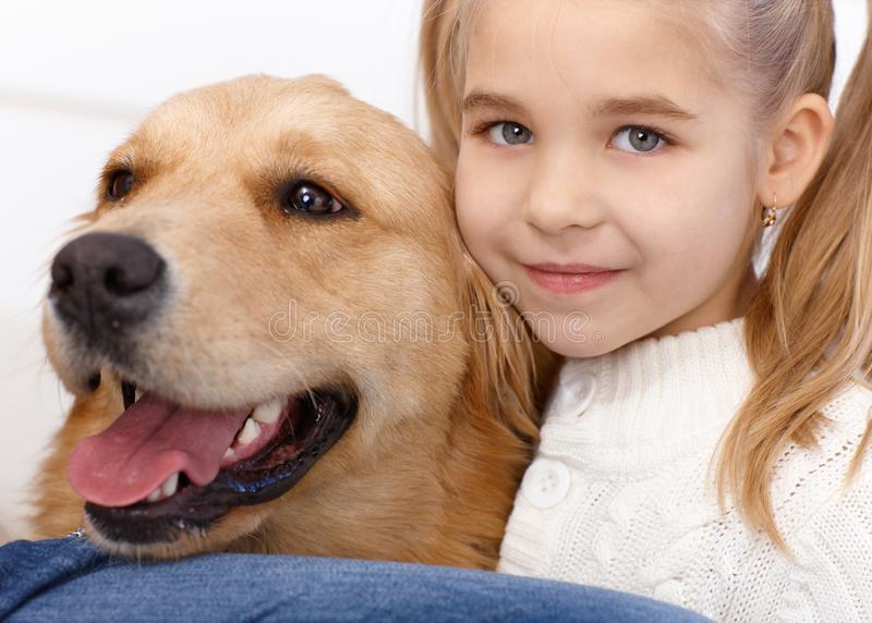 Portrait of lovely little girl and dog royalty free stock photos