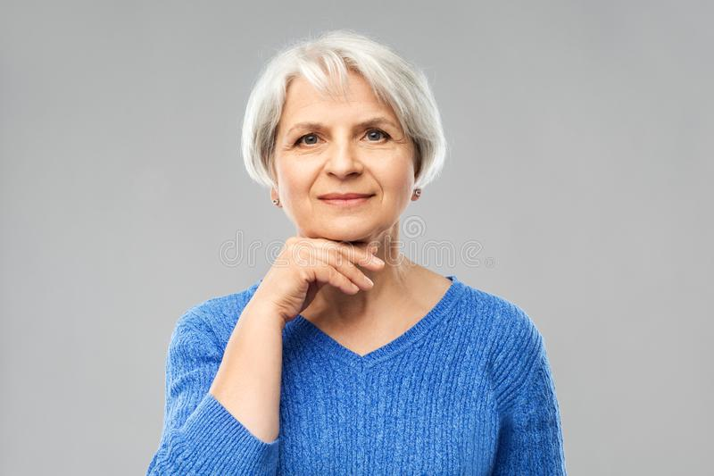 Portrait of lovely senior woman in blue sweater royalty free stock image