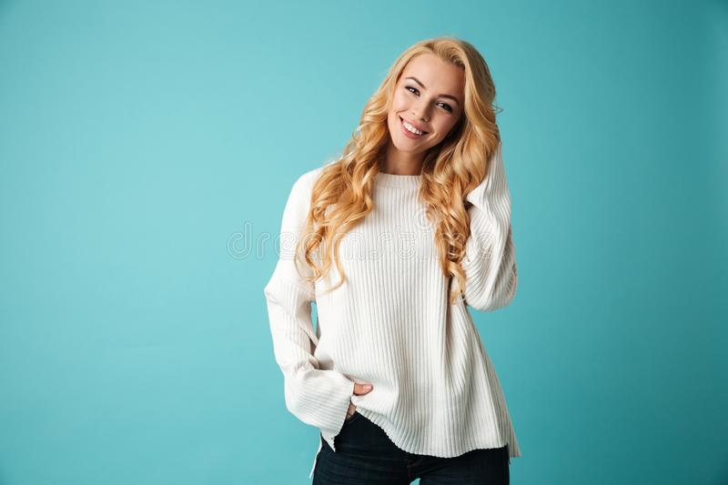 Portrait of a lovely young blonde woman in sweater royalty free stock photos