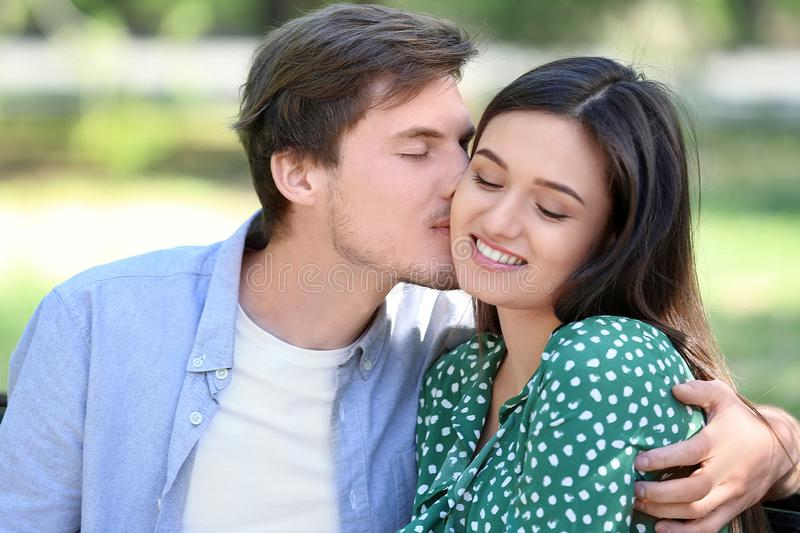 Portrait of lovely young couple in park stock image