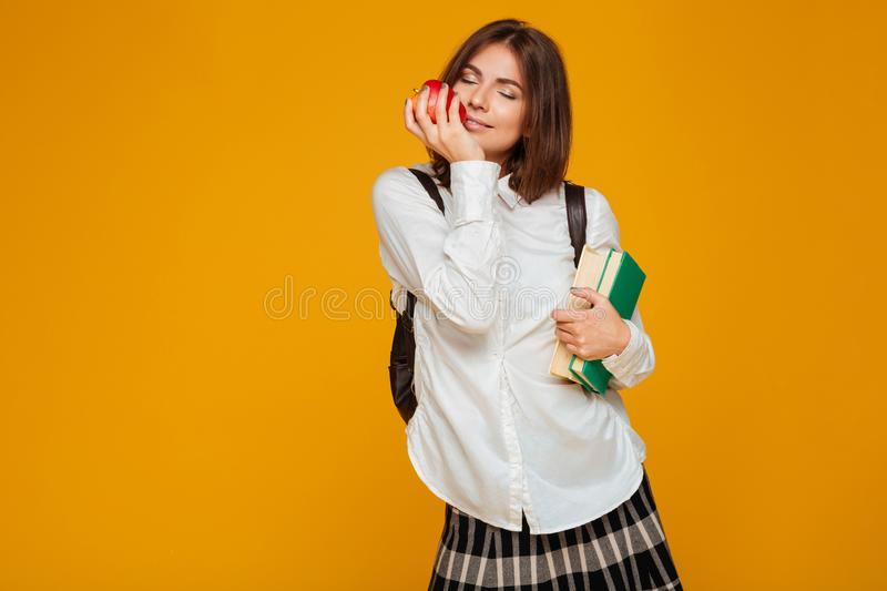 Portrait of a lovely young schoolgirl holding books royalty free stock photography