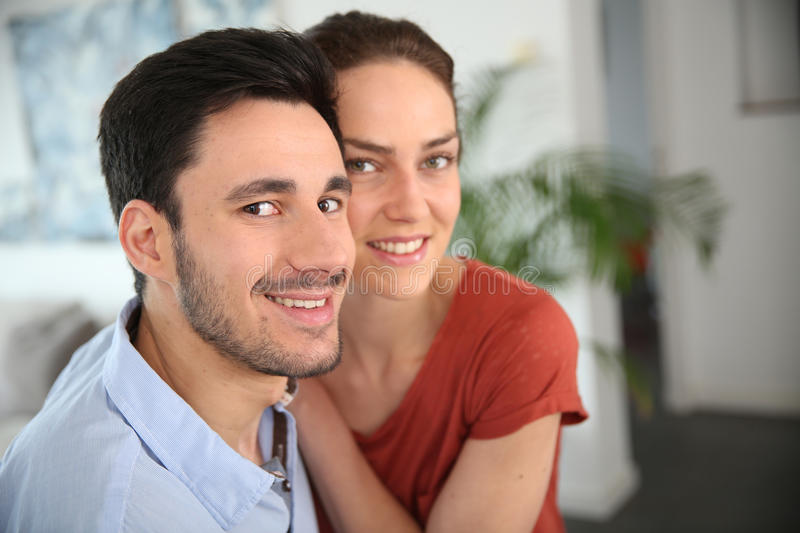 Portrait of loving couple sitting at home. Portrait of loving couple at home stock photos