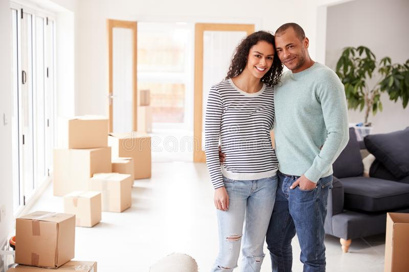 Portrait Of Loving Couple Surrounded By Boxes In New Home On Moving Day royalty free stock photo