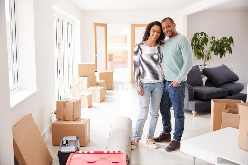 Portrait Of Loving Couple Surrounded By Boxes In New Home On Moving Day royalty free stock photography
