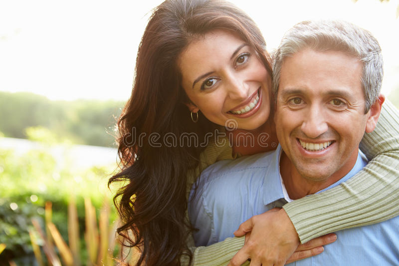 Portrait Of Loving Hispanic Couple In Countryside. Smiling At Camera royalty free stock photos