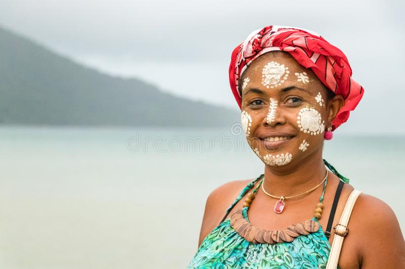 Malagasy woman with her face painted, Vezo-Sakalava tradition, Nosy Be, Madagascar royalty free stock image