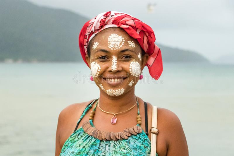 Malagasy woman with her face painted, Vezo-Sakalava tradition, Nosy Be, Madagascar stock images