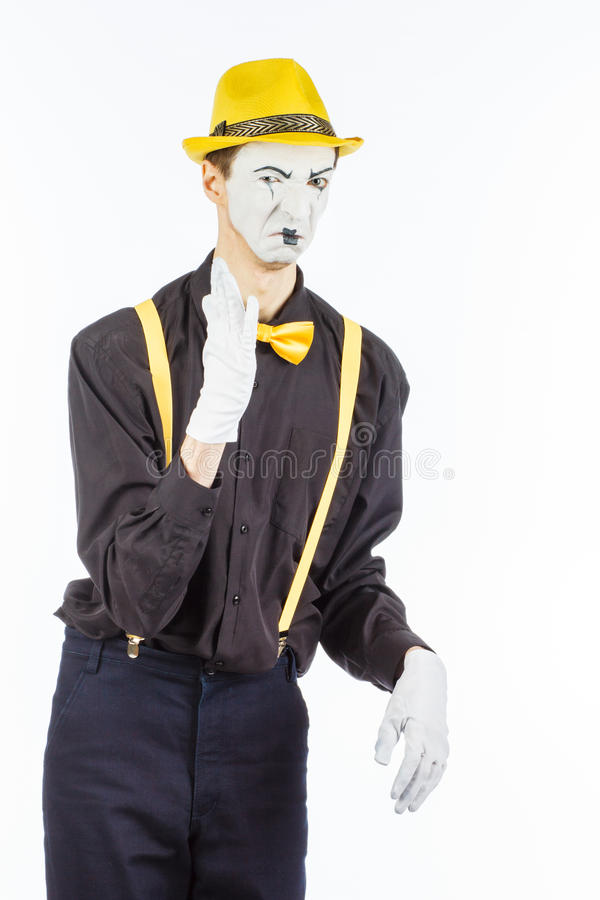 Portrait of a male actor, pantomime, covering his nose against a royalty free stock photos